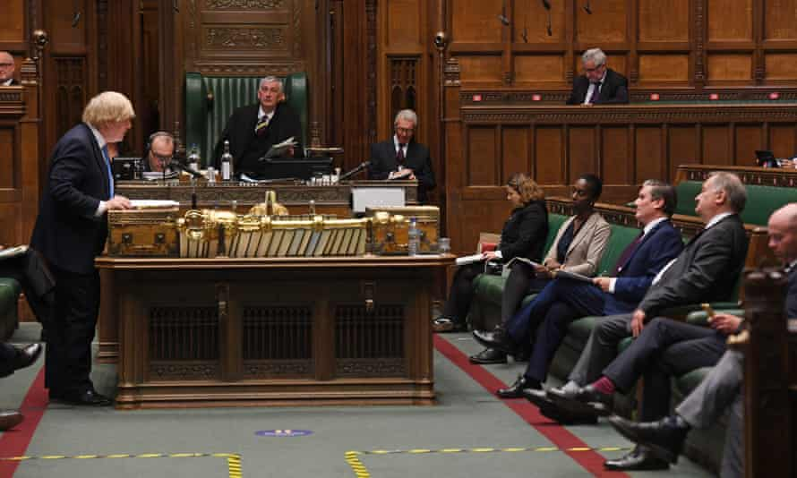 Boris Johnson speaks as the Labour frontbench listen during PMQs on 17 June
