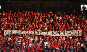 """Nîmes fans hold up a banner that reads """"with us no homophobia"""" before the start of the Ligue 1 match against Brest."""