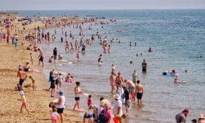 Beach goers in Devon, UK, during Aug 2018 heatwave.