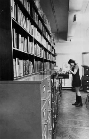 A librarian consulting the Guardian index in 1969. Started in Victorian times, the index filled dozens of leather-bound volumes five inches thick, comprising a year's entries in copper plate. Not until the 1930s was the system changed to cards. It was eventually given to Manchester Central Library but a microfilmed version can be found in the GNM archive (Archive ref. GUA/6/9/1/4/G).