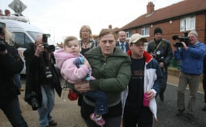 Karen Matthews (front) and partner Craig Meehan on Moorside, after Shannon was found, but before Matthews was accused of kidnapping her own daughter