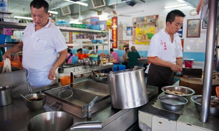 Chef preparing chicken and bean sprout dishes at Lou Wong restaurant, Ipoh, Malaysia.