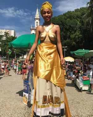 "Advertising professional Louise Bacelar, 23, as Dadara, warrior wife of 16th century black resistance leader Zumbi dos Palmares at Mulheres Rodadas. ""This is more than just a feminist street party,"" she said"