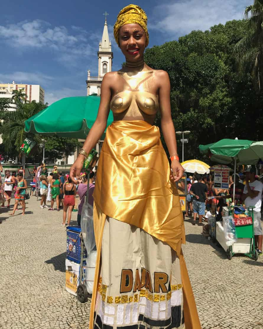 """Advertising professional Louise Bacelar, 23, as Dadara, warrior wife of 16th century black resistance leader Zumbi dos Palmares at Mulheres Rodadas. """"This is more than just a feminist street party,"""" she said"""
