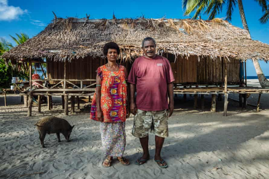 Mike and Alice from Killerton, Papua New Guinea. They had to move their house when it was threatened by flooding in 2007.