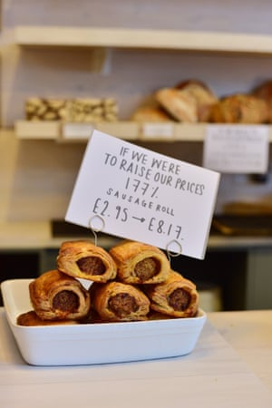 A sign showing the effect on the price of sausage rolls of a 177% increase at Two Magpies Bakery in Southwold.