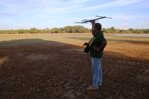 A Wildlife Conservation Department guard picks up signals from monitored elephants' collars