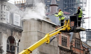 Workers cleaning the Cenotaph memorial in London.