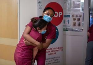 Senior staff nurse Patricia Barrazona becomes emotional and is comforted by staff nurse Adaobi Umeibekwe