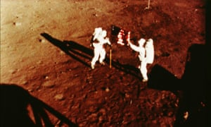 Neil Armstrong planting an American flag on the moon, Apollo 11 lunar landing, 1969.