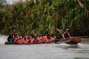 Boat full of migrants wearing lifejackets