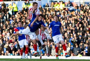 Southampton's Ricky Lambert heads in the opening goal against Portsmouth at Fratton Park on 18 December 2011.