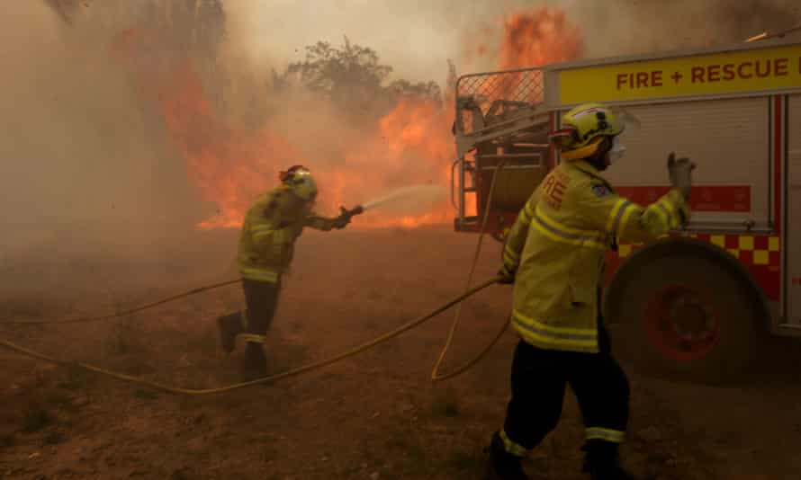 Firefighters battle a bushfire near Braidwood, New South Wales, on Friday.