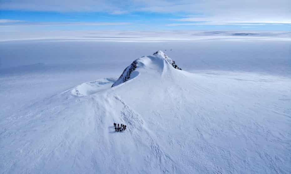 A group of explorers during a reconnaissance trip on the Edson glacier, Ellsworth Mountains, Antarctica.