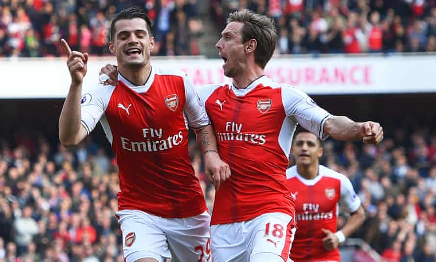 Granit Xhaka (left) celebrates with Nacho Monreal after the Swiss midfielder scored Arsenal's first against Manchester United at the Emirates Stadium.