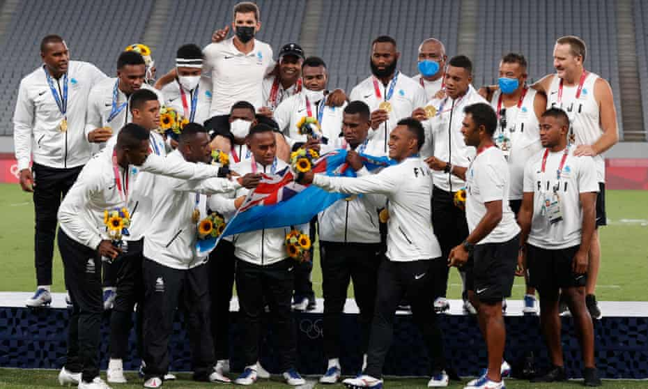 The sevens gold winners Fiji celebrate on the podium after retaining the title they won at Rio, for only the small Pacific nation's second Olympic medal.