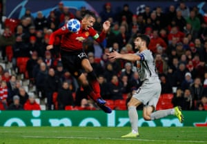 Manchester United's Chris Smalling beats Young Boys' Loris Benito to the ball but heads it the wrong side of the upright.