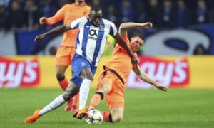 Liverpool's James Milner, right, tackles Porto's Moussa Marega in the Champions League this season.