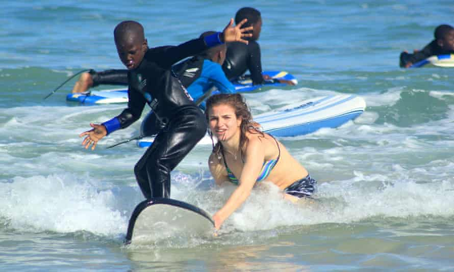 Jennifer Snell with kids from the Waves For Change foundation.