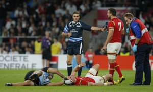 Liam Williams receives treatment before being stretchered off. Wales injury woes continue as Hallam Amos also goes off after overextending arm handing off Farrell
