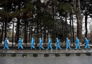 Kabul, Afghanistan Volunteers spray disinfectant on the streets and shops amid concerns about coronavirus