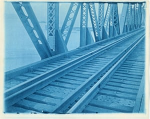 Crossing a bridge. Masters would often travel the railroads with his camera in order to get new ideas for his illustrations. This image was taken from the last carriage on the way to New York