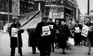 Demonstrators march along Whitehall to demand an increase in pensions.