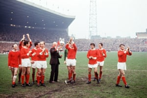 Manchester United manager Matt Busby holds the League Championship trophy as he and his players parade it around Old Trafford on 13 May 1967