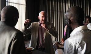 Laureus ambassador John Robbie chats with graduates of the Laureus YES programme in Johannesburg in 2014.