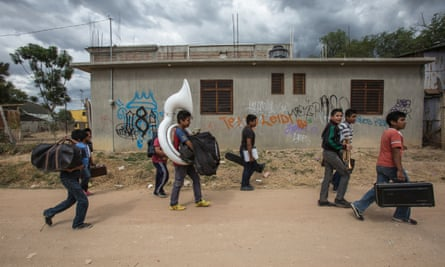 Band members carry their instruments home after practising at the Vicente Guerrero music school.