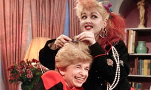 "Sex therapist Dr. Ruth Westheimer cracks up as rock singer Cyndi Lauper does her hair up in ""punk"" style, in New York, Jan. 17, 1985"