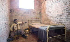 Prison cell at Spike Island with a pretend prisoner chained up
