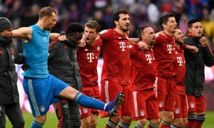 Bayern Munich players including Manuel Neuer (second from left) and Thomas Müller (fourth from left) celebrate victory over Wolfsburg.