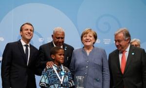 (L-R) French president, Emmanuel Macron, prime minister of Fiji, Frank Bainimarama, 12-year-old Timothy Naulusala, German chancellor, Angela Merkel and Antonio Guterres, secretary general of the UN.