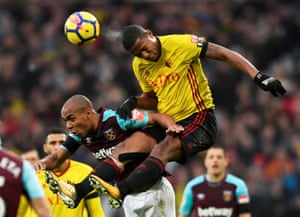Watford's Marvin Zeegelaar climbs above West Ham's Joao Mario at the London stadium. The Hammers won the game 2-0.