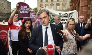 Julian Smith is surrounded by Bloody Sunday justice campaigners, Equal Marriage Rights protestors and Irish Language Act activists