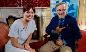 Blue Peter presenter Lindsey Russell presents Steven Spielberg with a gold Blue Peter badge