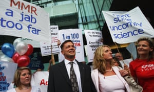 Andrew Wakefield and his then-wife Carmel in 2007, flanked by supporters ahead of an appearance before the GMC.