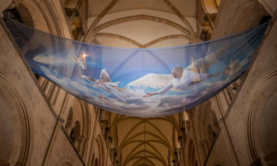Angels are printed on see-through fabric suspended over the chancel arch.