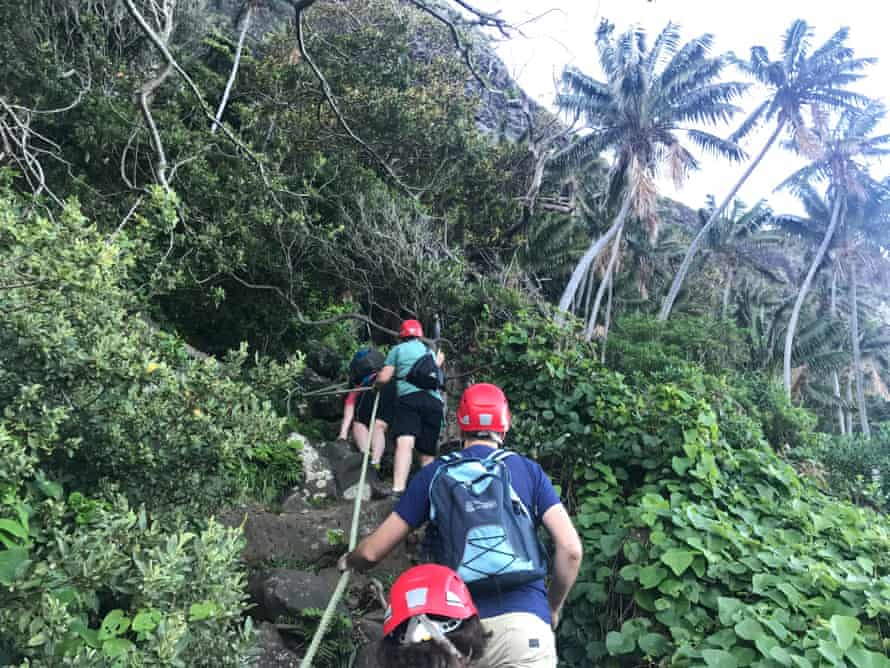 Climbing Mount Gower: walkers use ropes to haul themselves up steep sections of track.