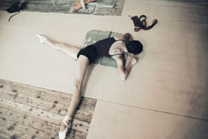 A young dancer stretches before a performance at the Donetsk Opera