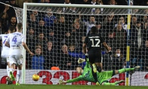 Bailey Peacock-Farrell saved a late penalty from Marc McNulty to ensure Leeds took second place in the Championship.