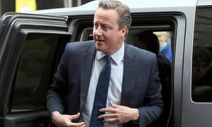 Under pressure: David Cameron arrives to address the Conservative spring forum in central London.