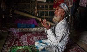 A Rohingya refugee prays in Bangladesh
