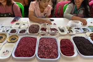 Sellers trading rubies and other gemstones at the gems market in Mogok town, north of Mandalay