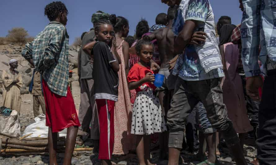 Tigrayans who have fled the fighting arrive in Hamdayet, eastern Sudan, near the border with Ethiopia, on Saturday.