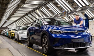 Workers assemble the new Volkswagen ID.4 electric SUV at the VW factory on September 18, 2020 in Zwickau, Germany.