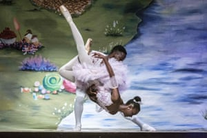 Two dancers performing a lift