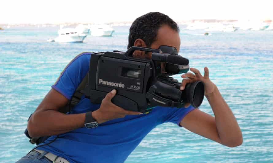 Man using a VHS camcorder