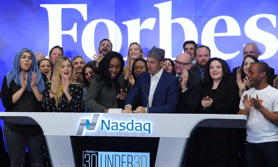 Amani al-Khatahtbeh, left, attends the ringing of the opening bell at the NASDAQ in New York in January 2016.